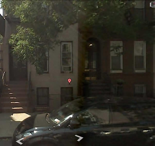 302 E 82 St--single width brownstone townhouse